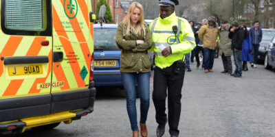 Image of police comforting lady